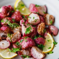 Roasted radishes with lemon in a bowl