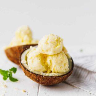 Pineapple coconut ice cream in a coconut bowl