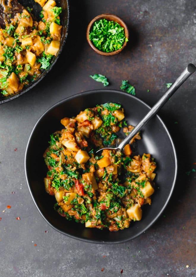 Vegan lentil stew in a black bowl