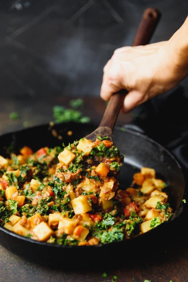 Lentil potato stew in a cast iron skillet