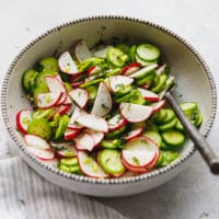 Cucumber radish salad with dill in a bowl