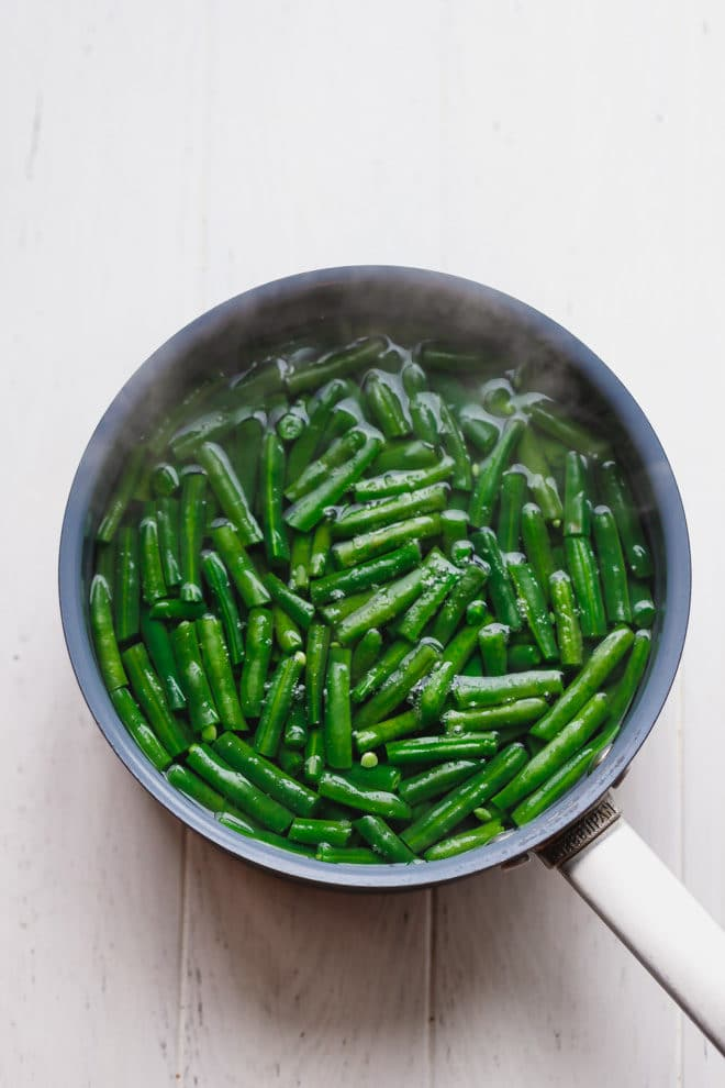 Green beans in a pot of hot water