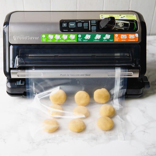 Low-carb sugar cookies unbaked in a bag being sealed with FoodSaver®