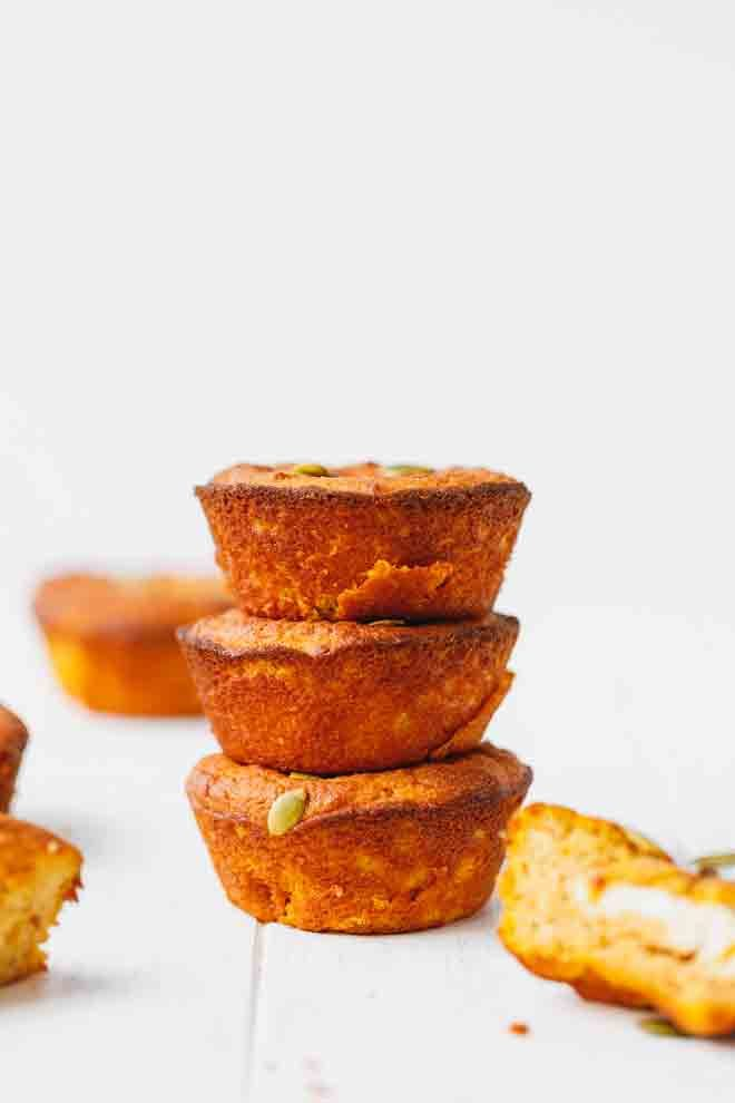 Three low-carb pumpkin muffins stacked on top of each other