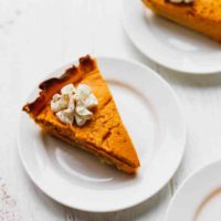 Keto low-carb pumpkin pie on a white plate
