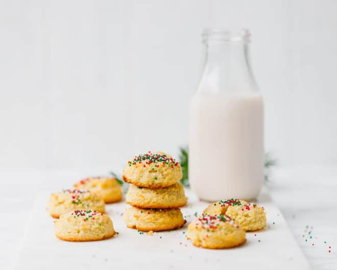 Keto, Low-Carb sugar cookies on top of each other with milk on the side