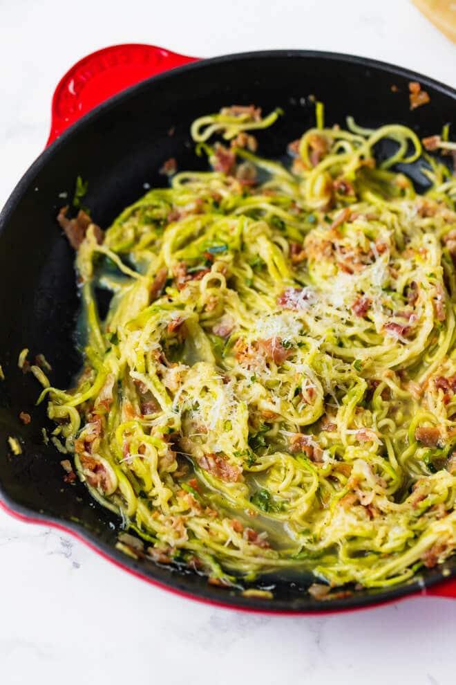 A pan with zucchini carbonara pasta