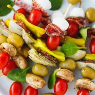 Colorful antipasto skewers on a plate