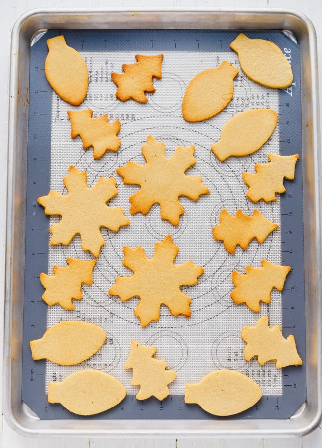 baked cut out cookies on a cookie sheet