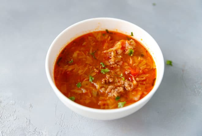 Cabbage soup in a white bowl