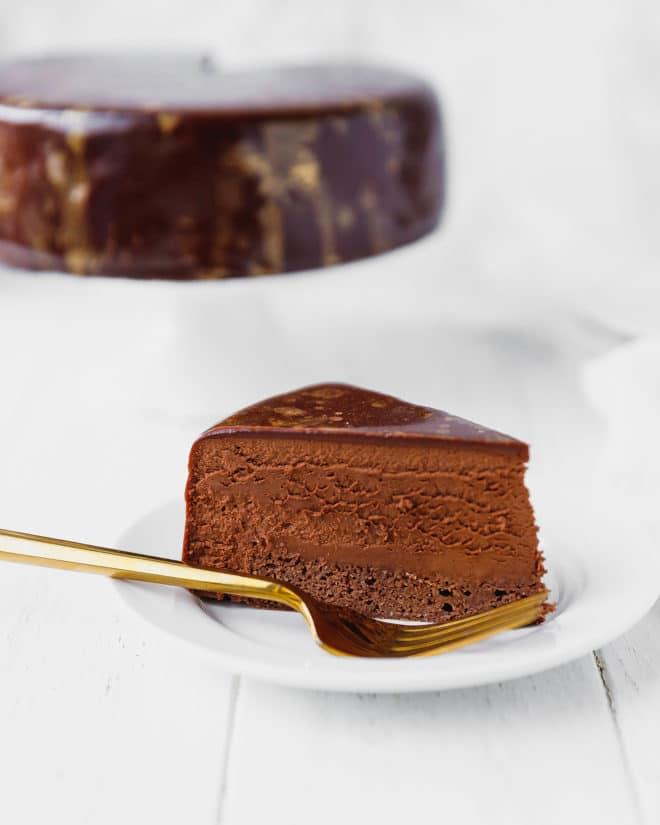 A slice of Mirror Glaze Cake on a plate
