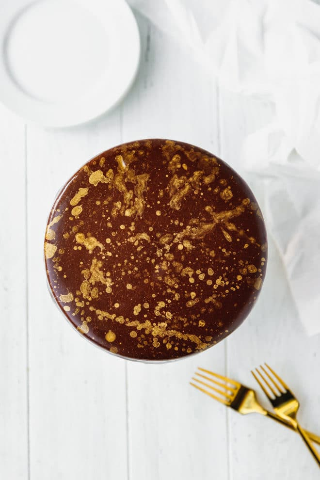 Chocolate mirror glaze cake with gold leaf