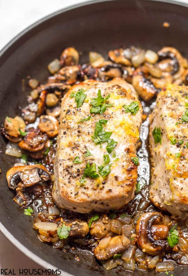 Garlic butter pork chops with mushrooms in a pan