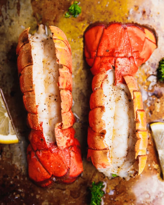 Broiled lobster tails on a baking sheet