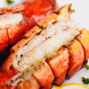 The Best Broiled Lobster Tail on a baking sheet