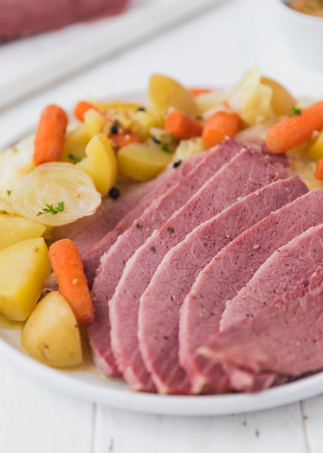 Corned beef and cabbage on a round white plate