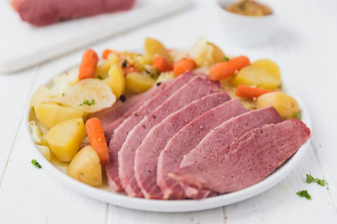 Corned beef and cabbage with potatoes and carrots on a plate