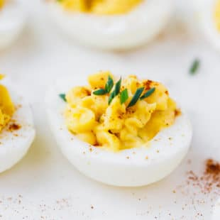 DEVILED EGG TOPPED WITH PAPRIKA AND CHIVES