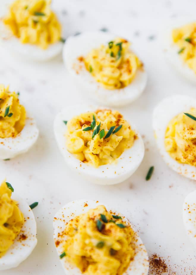 Deviled eggs with pickles on a platter