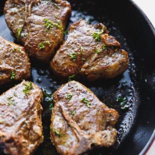 Lamb loin chops in a skillet