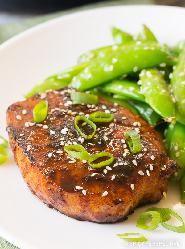 Pan fried Korean pork chops on a plate