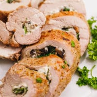 Stuffed pork tenderloin sliced on a plate
