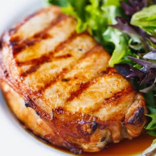Grilled beer marinated pork chops on a plate