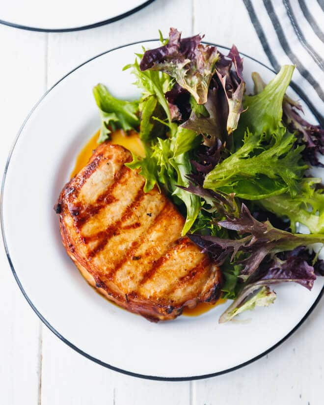 Grilled boneless pork chops on a plate