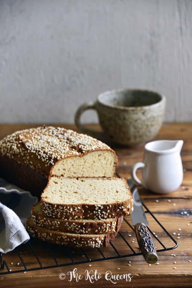 Keto bread loaf on a cooling rack