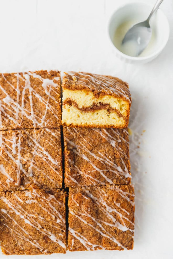 Cinnamon coffee cake on parchment paper cut into squares