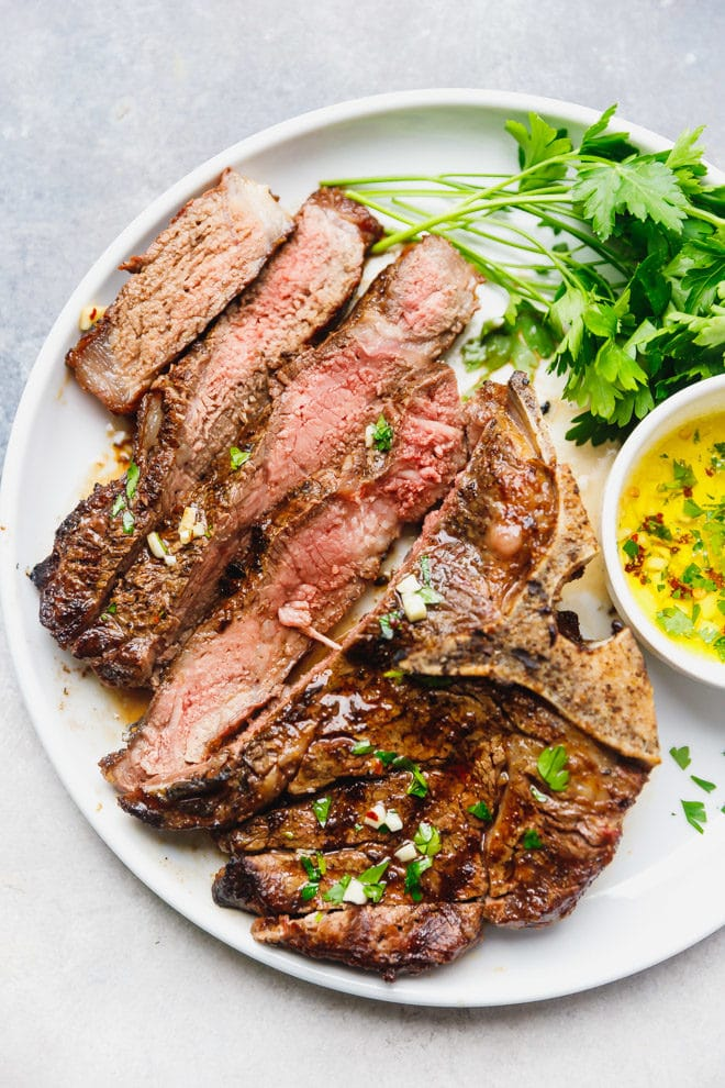 Grilled and sliced t bone steak on a plate