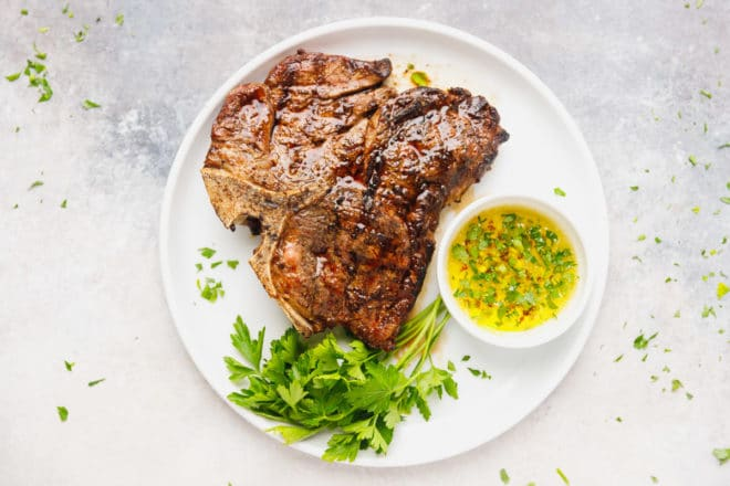 T bone steak with garlic butter on a plate