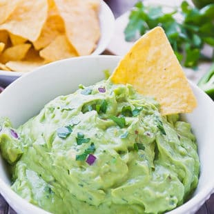 BLENDER GUACAMOLE IN A WHITE BOWL
