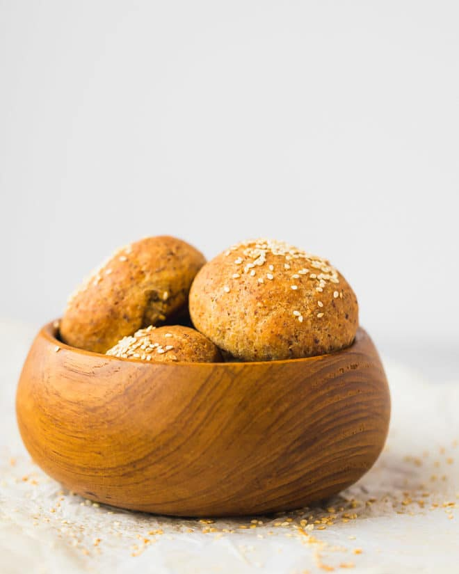 Keto flax bread rolls in a bamboo bowl