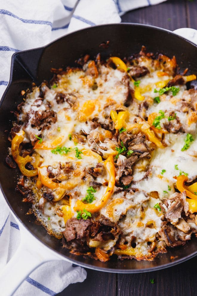 Philly cheesesteak in a white skillet