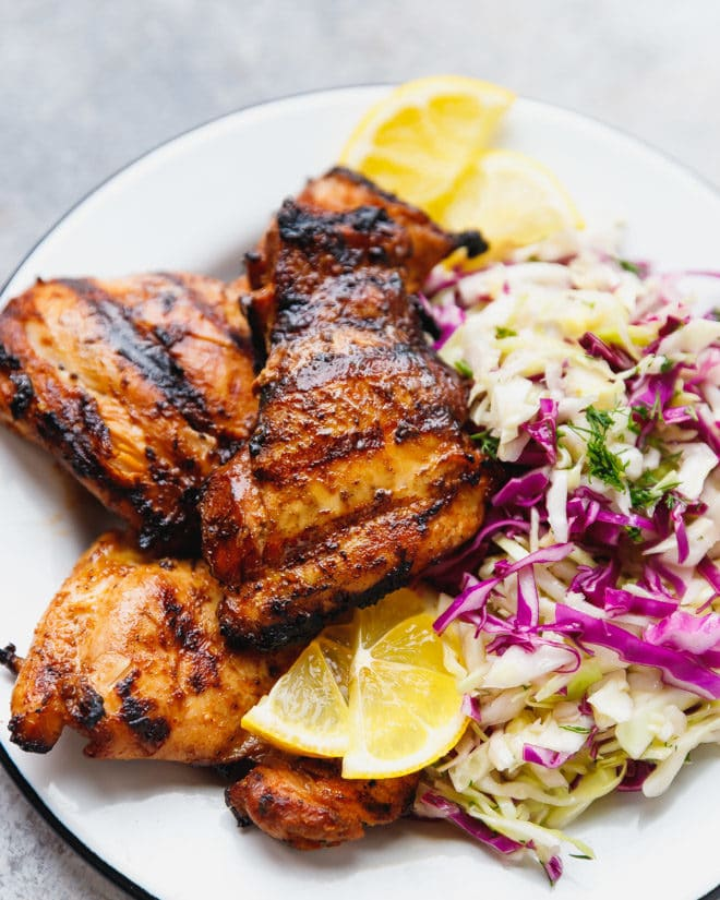 Grilled chicken thighs on a plate