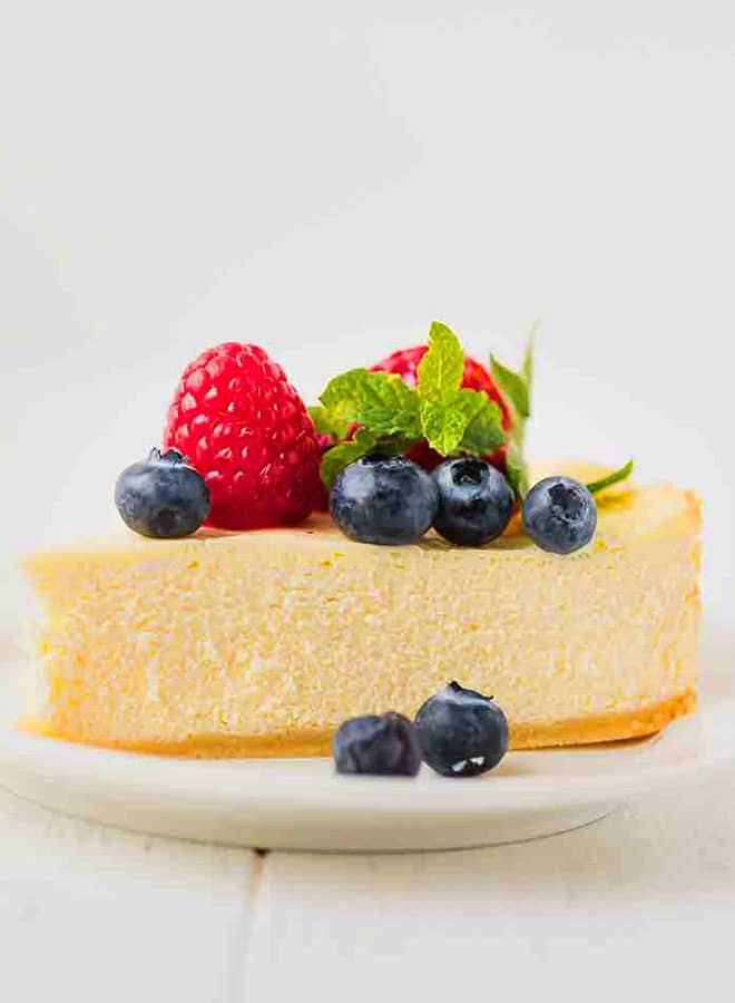 A slice of Keto cheesecake on a white plate
