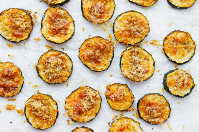 baked zucchini chips topped with parmesan