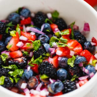 fresh berry salsa in a white bowl