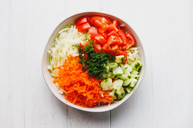 Colorful cabbage carrot salad in a bowl