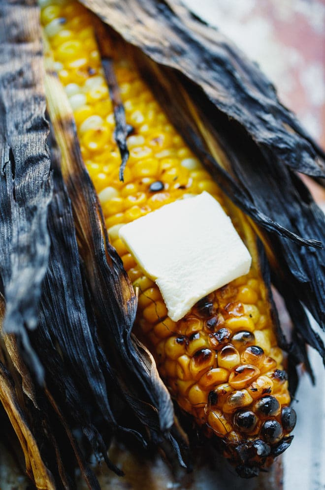 Grilled corn on the cob topped with butter