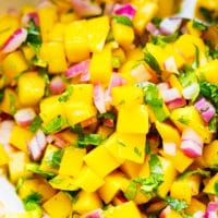 Colorful mango salsa in a white bowl