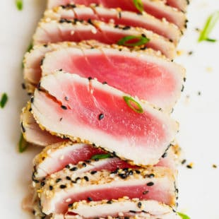 Sliced Sesame Crusted Ahi Tuna. on a cutting board