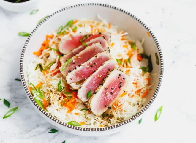 Sliced seared ahi tuna over a salad