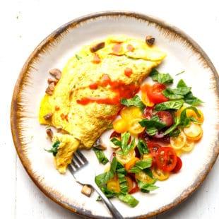 Mushroom spinach omelette on a ceramic plate