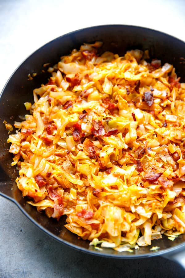 Golden brown bacon and cabbage in a pan
