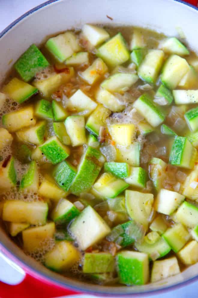 Zucchini cut into cubes in a pot