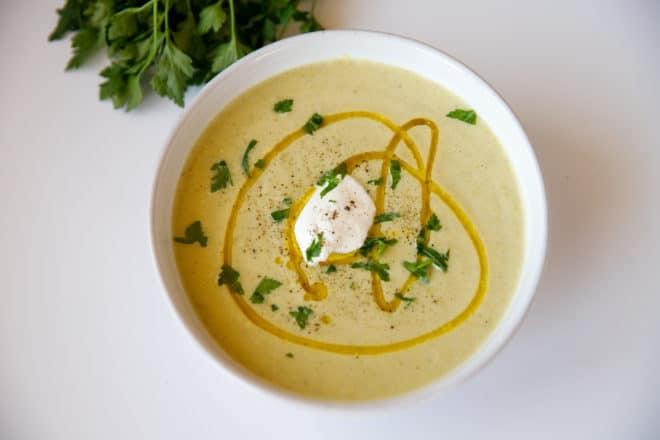 Zucchini soup in a white ceramic bowl