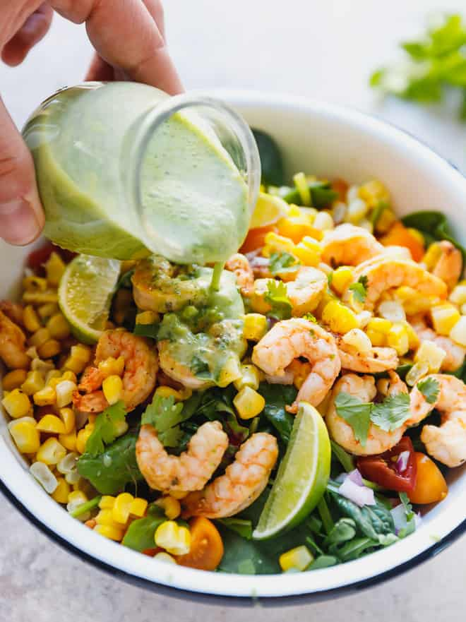 Cilantro lime dressing poured over a Mexican style colorful salad