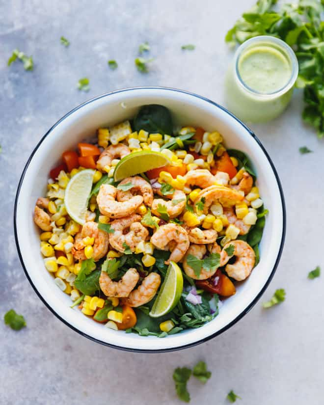 Colorful Mexican shrimp salad in a white bowl